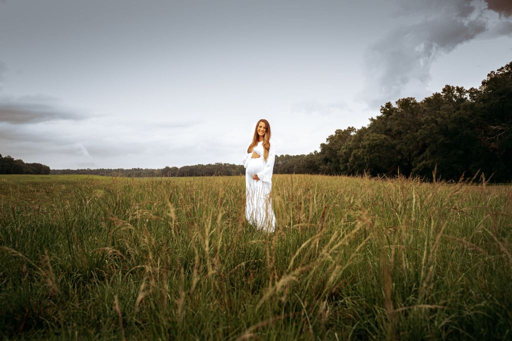 pregnant mother standing in a tampa maternity session