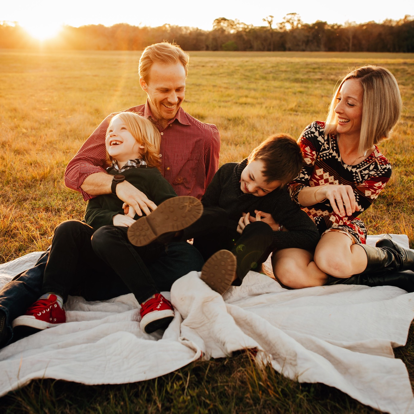 Family tickling their children during tampa family photo session