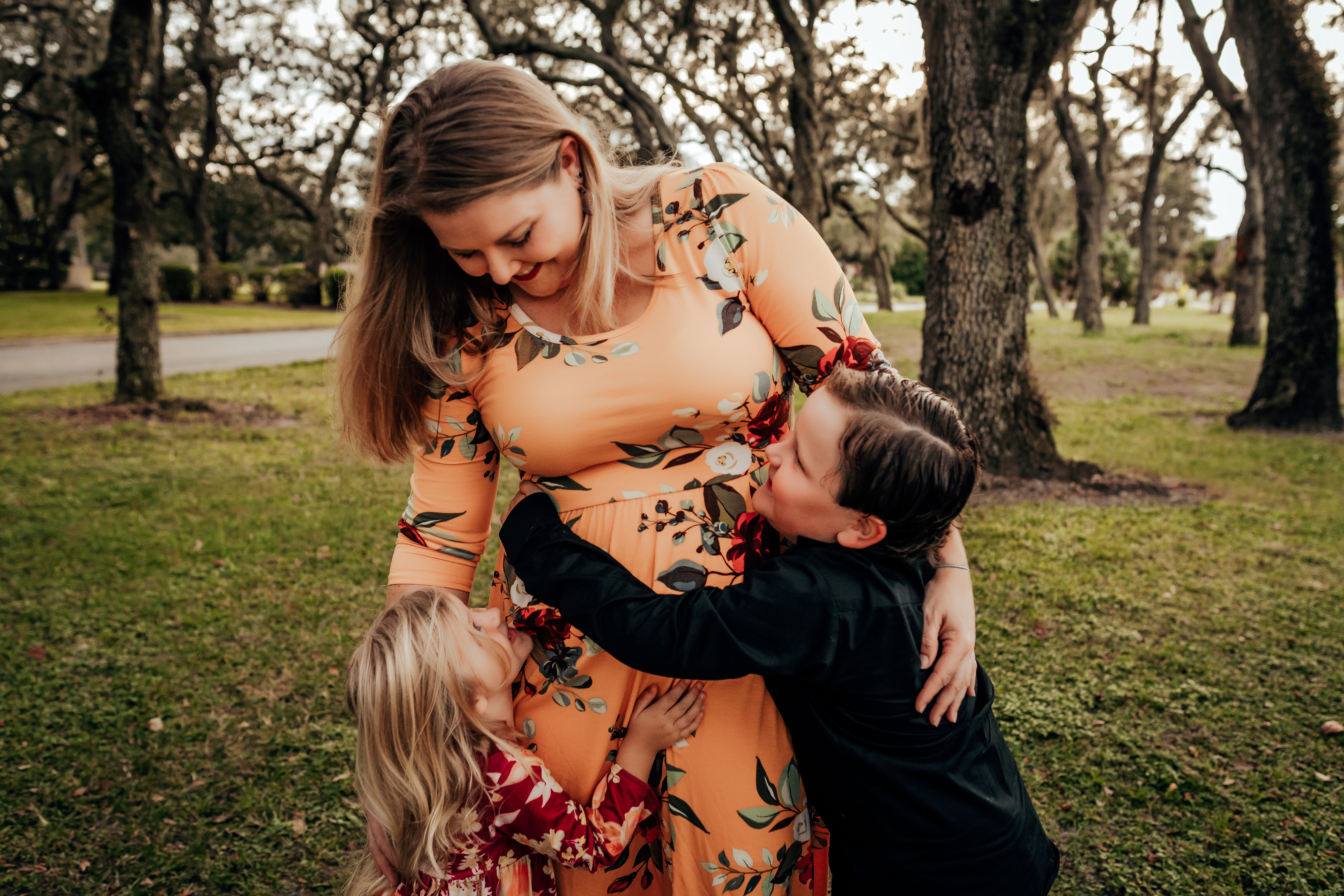 Mom hugging her children during family photo session in Tampa, Florida